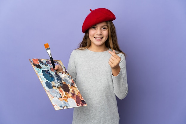 Artist girl over isolated background making money gesture