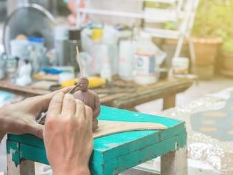 Artist making detail of resin female figure
