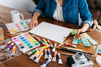 Artist painting at desk