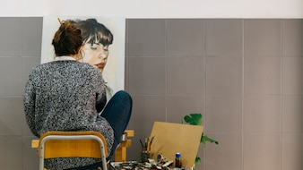 Artist painting female portrait