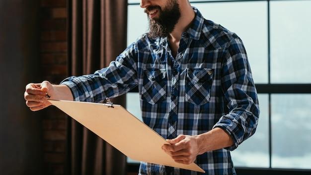 Artist painting in his studio workspace
