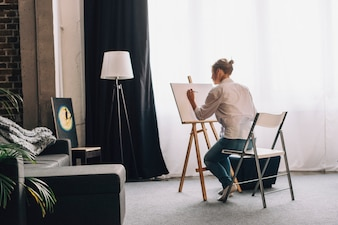 Artist painting in living room