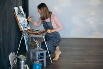 Artist painting in studio