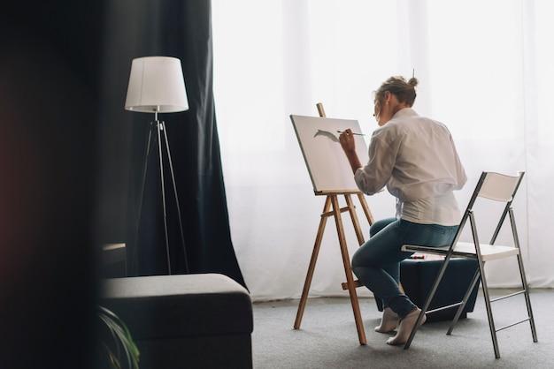 Artist painting in room
