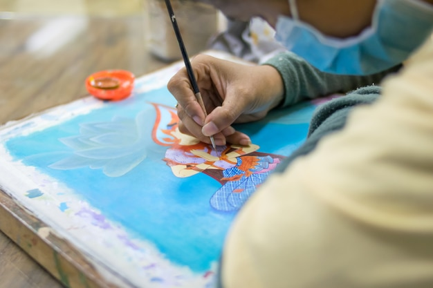 Artist paints picture on fabric