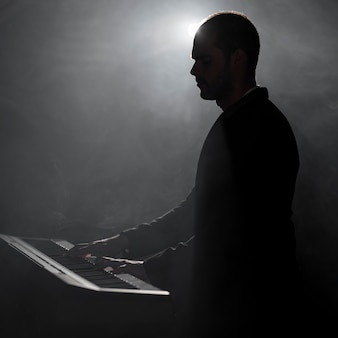 Artist playing piano smoke and shadows effects