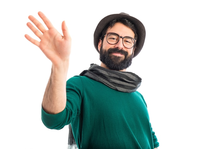 Artist saluting over white background