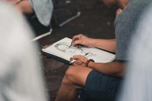 Artist sketching a portrait in hanoi vietnam