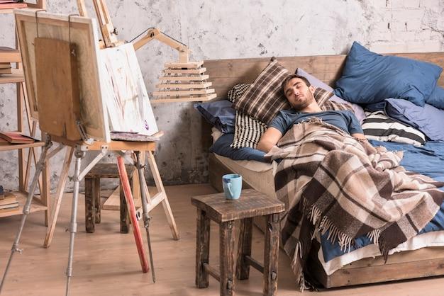 Artist sleeping in studio