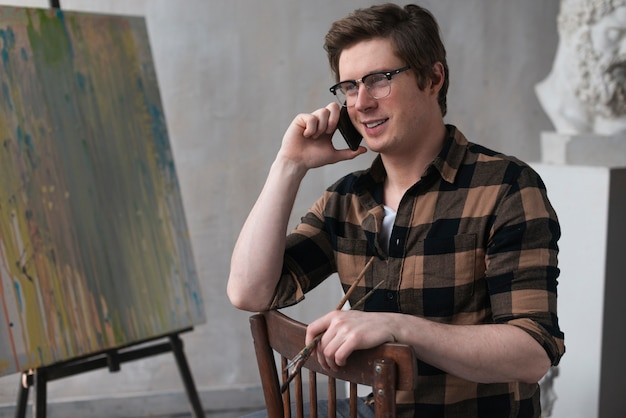 Artist talking on the phone