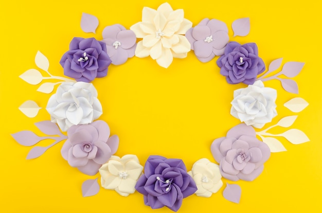 Artistic circular floral frame with yellow background