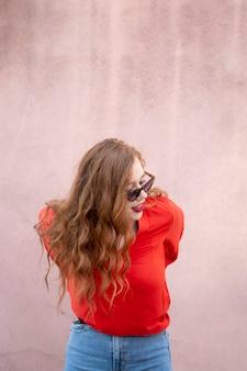 Artistic fashion posing with redhead woman