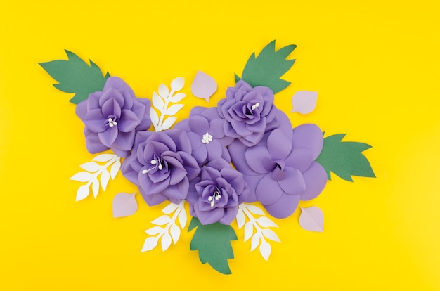 Artistic floral arrangement with yellow background