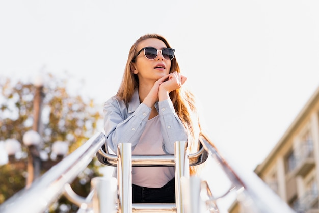 Artistic photo of blonde woman with sunglasses