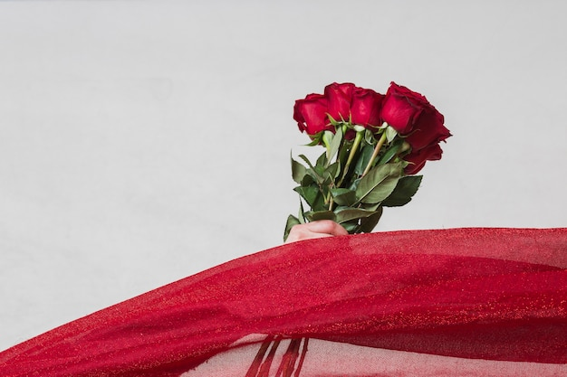 Artistic photo of roses on grey table