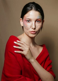 Artistic pose of woman with painted face
