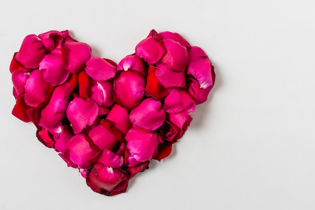 Artistic red roses in shape of a heart