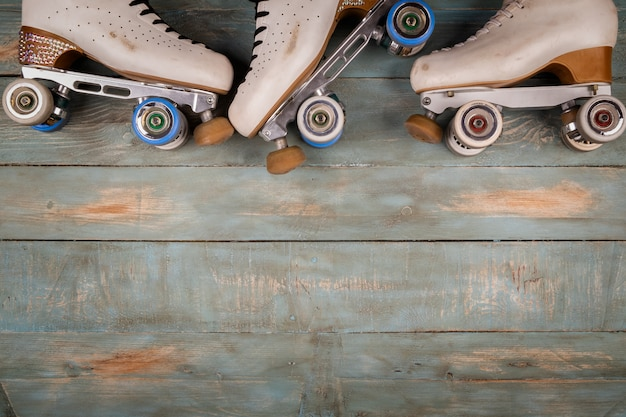 Artistic roller skates on a wood background