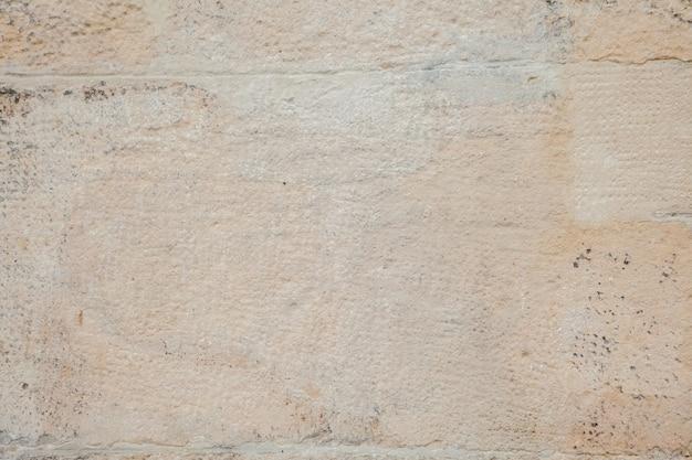 예술적 사암 벽 질감 배경 패턴 클로즈업입니다.