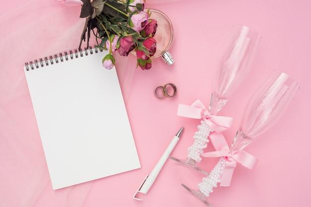 Artistic wedding arrangement on pink background