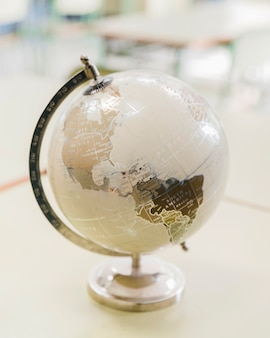 Artistic white and silver globe on desk