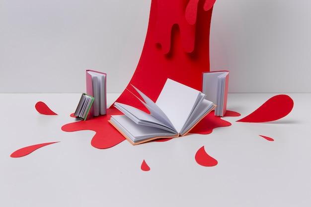 Arrangiamento di soggetti artistici con vernice rossa