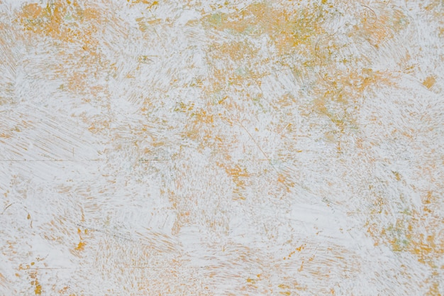 Artwork. close up of abstract white watercolor painting art on orange and yellow wall