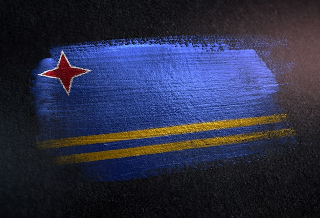 Aruba flag made of metallic brush paint on grunge dark wall