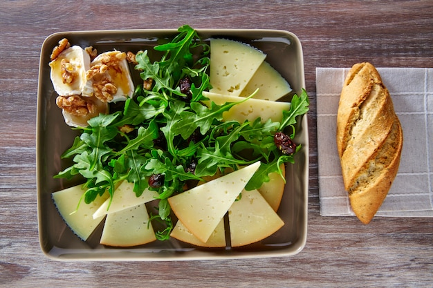Arugula salad with goat cheese honey and nuts