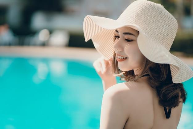Asain women with bikini enjoy summ er vacation