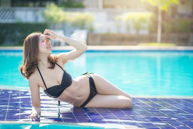 Asain women with bikini enjoy summer vacation