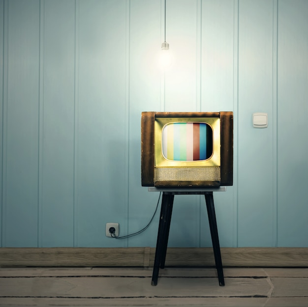 Ascetic vintage interior with old tv and a lamp
