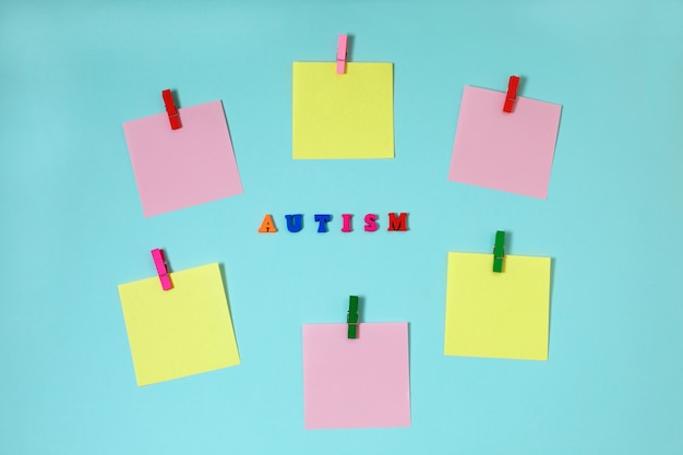 Asd, autism concept with paper stickers on blue background