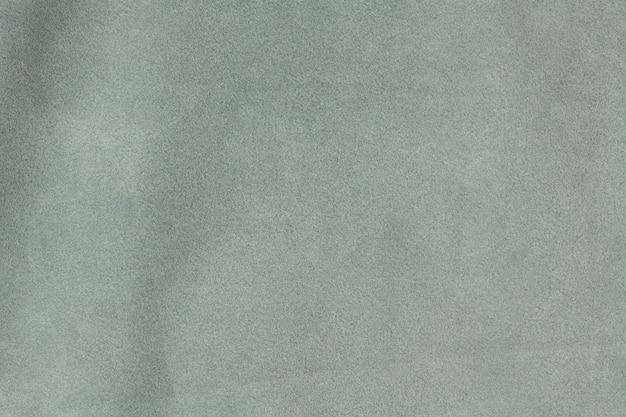 アッシュグレーのテクスチャードスエードレザーの表面の背景