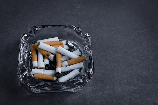 Ashtray with many cigarettes that smokers only can smoke in the limit smoking area,stop smoking.quitting from addiction concept.