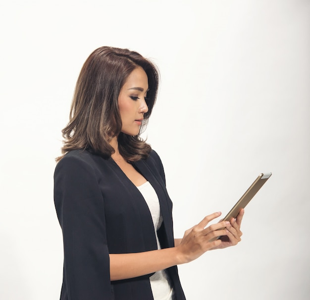 Asia business woman use tablet on white