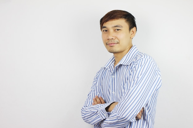 Asia of businessman with action on concrete wall background.