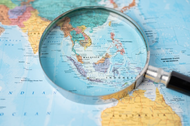 Asia, magnifying glass close up with colorful world map