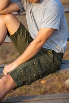 Asia man in bermuda shorts and t-shirt