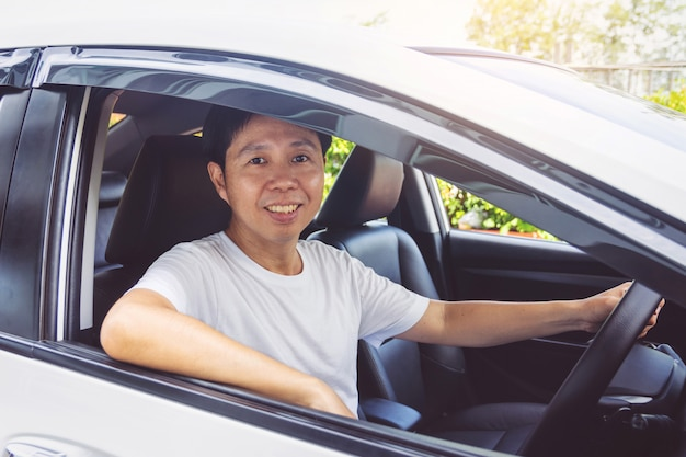Asia man smile happy and drive car