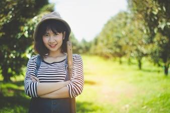 Asia teen, girl smiles posing with happy in the fruit garden.