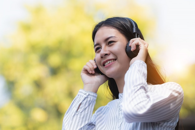 Asia woman listening to music with relax and happy in free time.