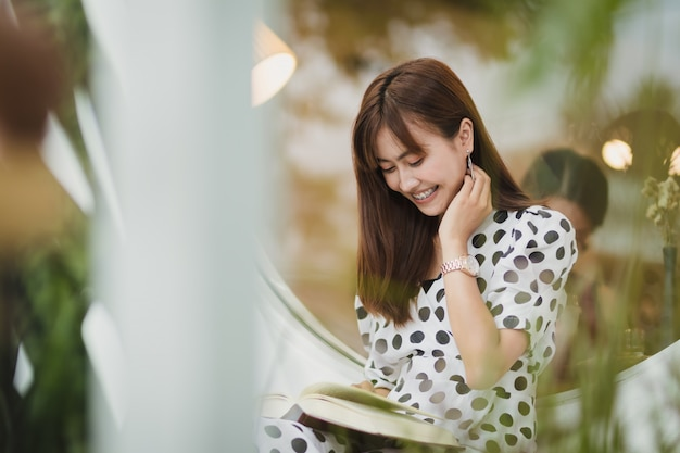 Asia woman reading book in free time with happiness