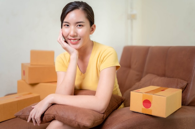 Asia woman start up for business online. people with online shopping sme entrepreneur or freelance working concept. banner size