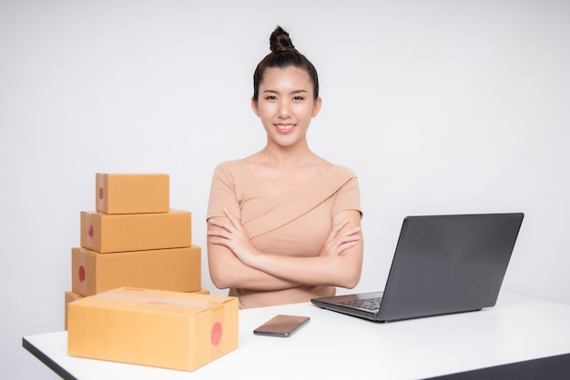 Asia woman start up for business online. people with online shopping sme entrepreneur or freelance working concept.