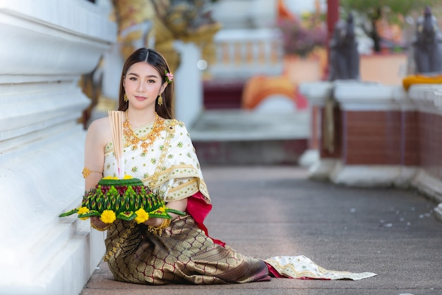 Asia woman in thai dress traditional hold kratong loy krathong festival