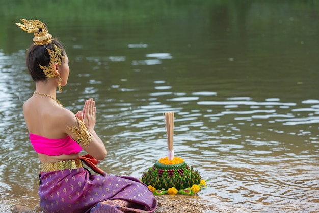 Asia woman in thai dress traditional hold kratong. loy krathong festival