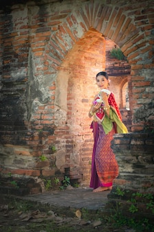 Asia woman in thai dress traditional-noppamas queen contest in loy kratong