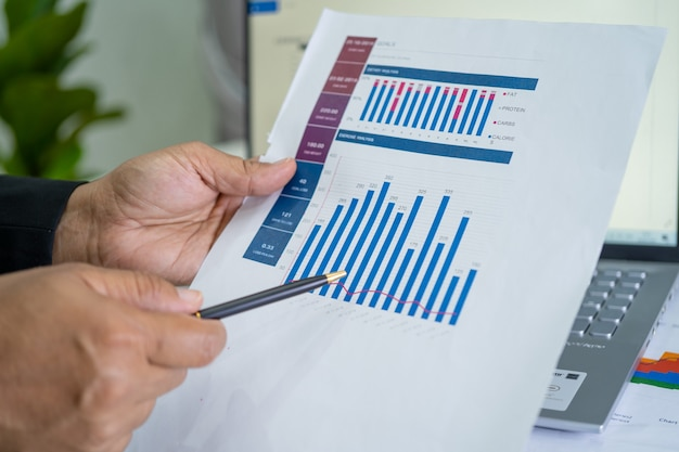 Asian accountant working and analyzing financial reports project accounting