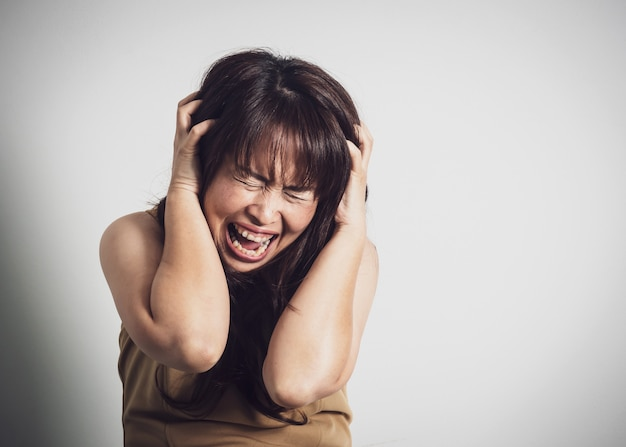 Asian adult woman screaming.